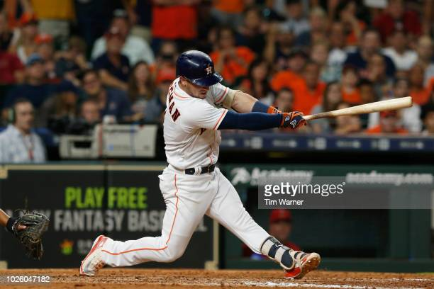 Alex Bregman of the Houston Astros hits a line drive for an out in the eighth inning against the Los Angeles Angels of Anaheim at Minute Maid Park on...