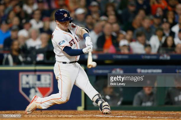 Alex Bregman of the Houston Astros hits a RBI double in the fifth inning against the Boston Red Sox during Game Three of the American League...