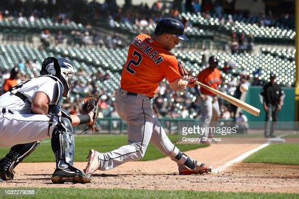 Alex Bregman of the Houston Astros hits a RBI single in the third inning in front of James McCann of the Detroit Tigers at Comerica Park on September...