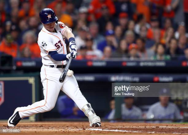 Alex Bregman of the Houston Astros hits a sac fly in the second inning of Game 3 of the 2017 World Series against the Los Angeles Dodgers at Minute...