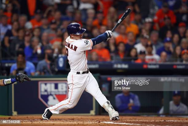 Alex Bregman of the Houston Astros hits a sacrifice fly during the second inning against the Los Angeles Dodgers in game three of the 2017 World...
