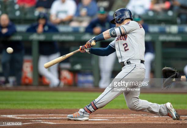 Alex Bregman of the Houston Astros hits a single off of starting pitcher Mike Leake of the Seattle Mariners during the first inning of a game at...