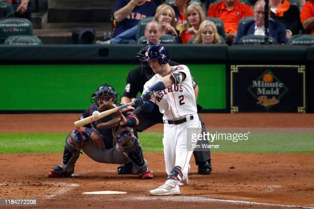 Alex Bregman of the Houston Astros hits a solo home run against the Washington Nationals during the first inning in Game Six of the 2019 World Series...