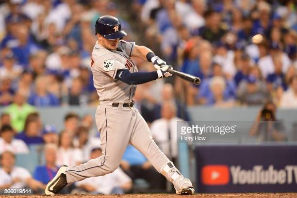 Alex Bregman of the Houston Astros hits a solo home run during the fourth inning against the Los Angeles Dodgers in game one of the 2017 World Series...