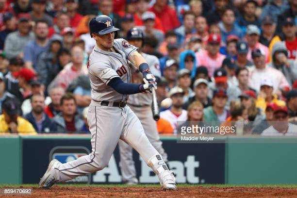Alex Bregman of the Houston Astros hits a solo home run in the eighth inning against the Boston Red Sox during game four of the American League...