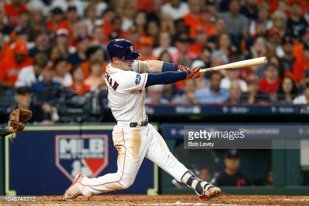 Alex Bregman of the Houston Astros hits a solo home run in the seventh inning against the Cleveland Indians during Game Two of the American League...