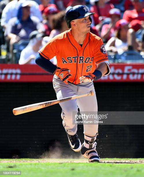 Alex Bregman of the Houston Astros hits a two RBI double in the seventh inning against the Los Angeles Angels of Anaheim at Angel Stadium on July 22...