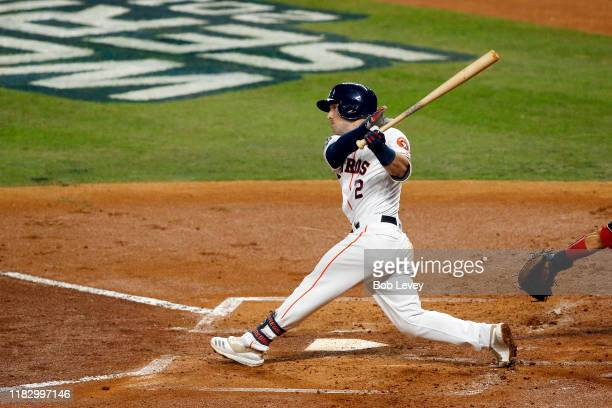 Alex Bregman of the Houston Astros hits a two-run home run against the Washington Nationals during the first inning in Game Two of the 2019 World...