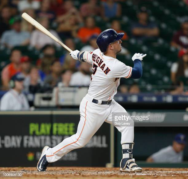 Alex Bregman of the Houston Astros hits a tworun home run in the ninth inning against the Texas Rangers at Minute Maid Park on July 28 2018 in...