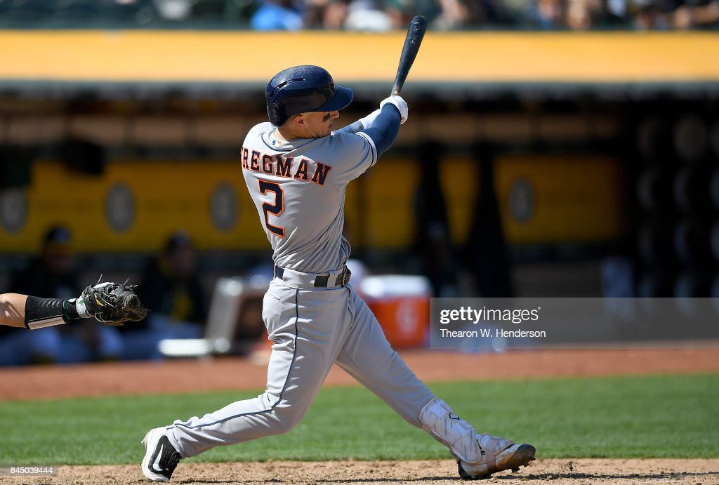 Alex Bregman #2 of the Houston Astros hits an RBI double scoring Max Stassi #12 against the Oakland Athletics in the top of the fifth inning during game one of a doubleheader at Oakland Alameda Coliseum on September 9, 2017 in Oakland, California.