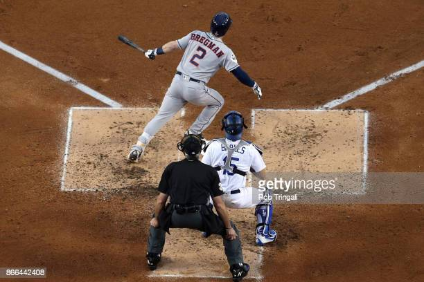 Alex Bregman of the Houston Astros hits an RBI single in the third inning during Game 2 of the 2017 World Series against the Los Angeles Dodgers at...