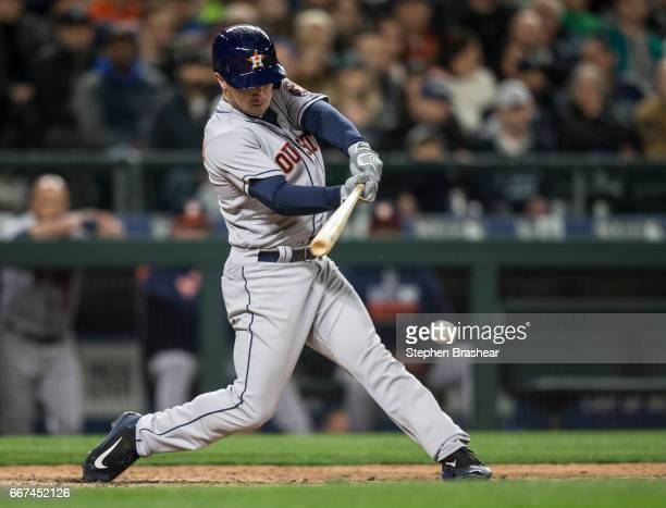 Alex Bregman of the Houston Astros hits an RBIsingle off os relief pitcher James Pazos of the Seattle Mariners to score Jake Marisnick of the Houston...