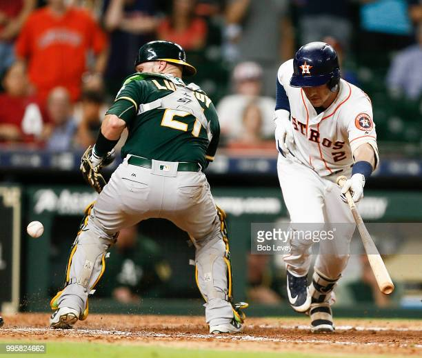 Alex Bregman of the Houston Astros hits ground ball to the catcher in the eleventh inning allowing Kyle Tucker on a throwing error by Jonathan Lucroy...