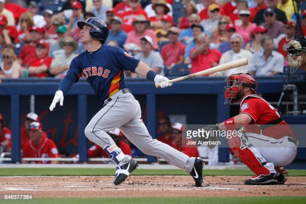 Alex Bregman of the Houston Astros hits the ball against the Washington Nationals in the first inning during a spring training game at The Ballpark...