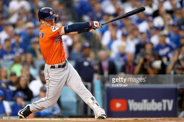 Alex Bregman of the Houston Astros hits the ball in the first inning and reaches second safely on a throwing error against the Los Angeles Dodgers in...
