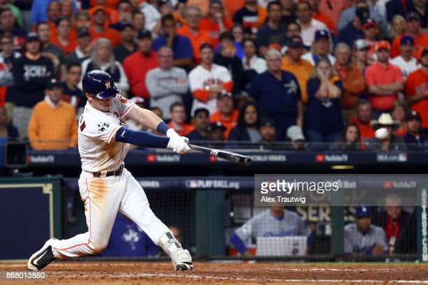 Alex Bregman of the Houston Astros hits the gamewinning RBI single in the 10th inning during Game 5 of the 2017 World Series against the Los Angeles...