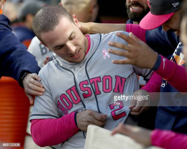 Alex Bregman of the Houston Astros is congratulated after he hit a grand slam in the first inning against the New York Yankees in Game 2 on May 14...