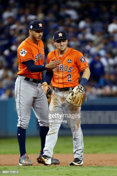 Alex Bregman of the Houston Astros is congratulated by Carlos Correa after making a great defensive play in the second inning during Game 7 of the...