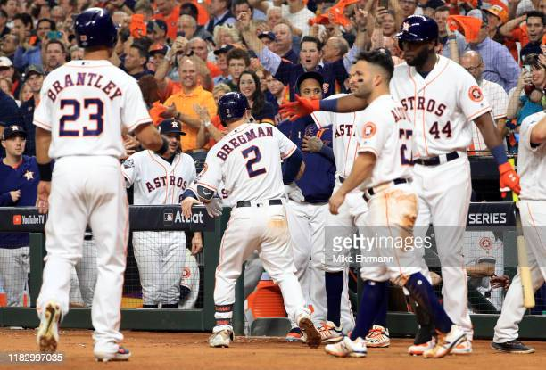 Alex Bregman of the Houston Astros is congratulated by his teammates after hitting a two-run home run against the Washington Nationals during the...