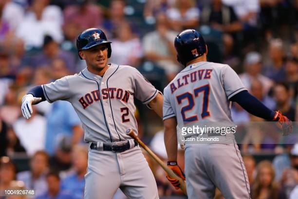 Alex Bregman of the Houston Astros is congratulated by Jose Altuve after hitting a two run home run in the first inning against the Colorado Rockies...