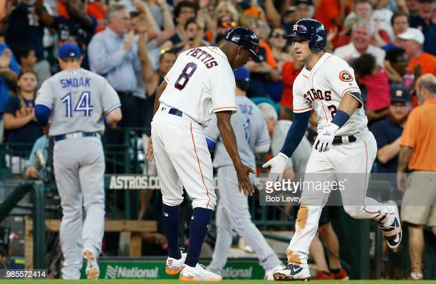 Alex Bregman of the Houston Astros is congratulated by third base coach Gary Pettis after hitting a walkoff tworun home run in the ninth inning to...