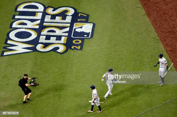 Alex Bregman of the Houston Astros is greeted by Jose Altuve and Carlos Correa after hitting a solo home run during Game 1 of the 2017 World Series...