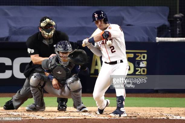 Alex Bregman of the Houston Astros is hit by a pitch from Ryan Yarbrough of the Tampa Bay Rays as Michael Perez catches during the third inning in...