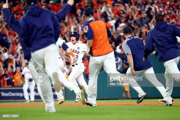 Alex Bregman of the Houston Astros is mobbed by teammates after hitting the gamewinning RBI single in the 10th inning during Game 5 of the 2017 World...