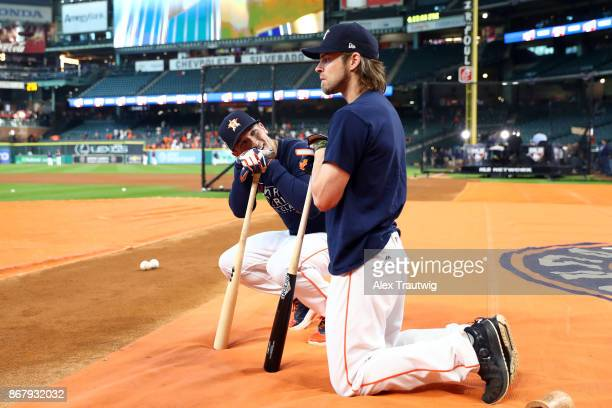 Alex Bregman of the Houston Astros jokes with Josh Reddick during batting practice prior to Game 5 of the 2017 World Series against the Los Angeles...