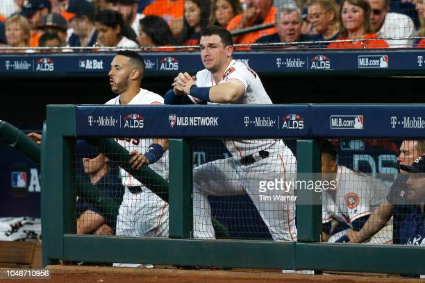Alex Bregman of the Houston Astros looks on from the dugout against the Cleveland Indians during Game Two of the American League Division Series at...