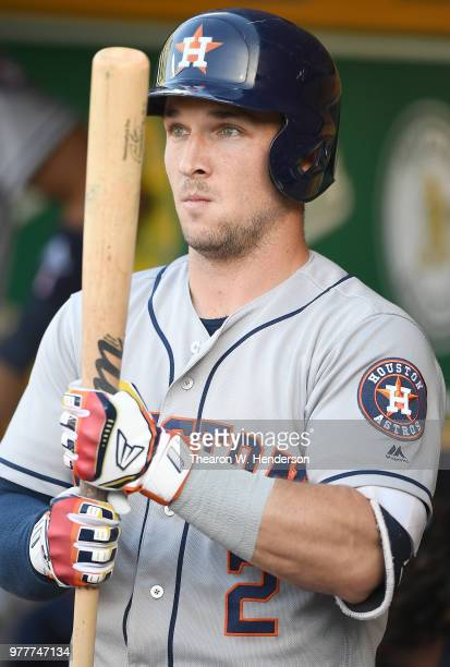 Alex Bregman of the Houston Astros looks on from the dugout against the Oakland Athletics prior to the start of the game at the Oakland Alameda...