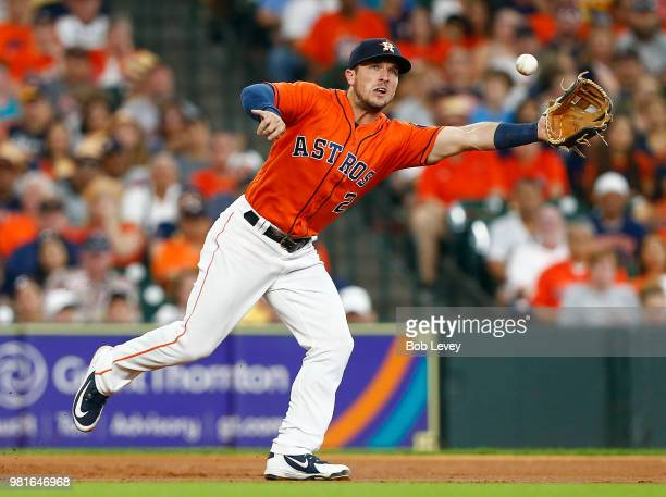 Alex Bregman of the Houston Astros makes a play on a ball hit by Rosell Herrera of the Kansas City Royals in the third inning at Minute Maid Park on...