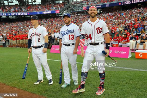 Alex Bregman of the Houston Astros Max Muncy of the Los Angeles Dodgers and Bryce Harper of the Washington Nationals look on during player...