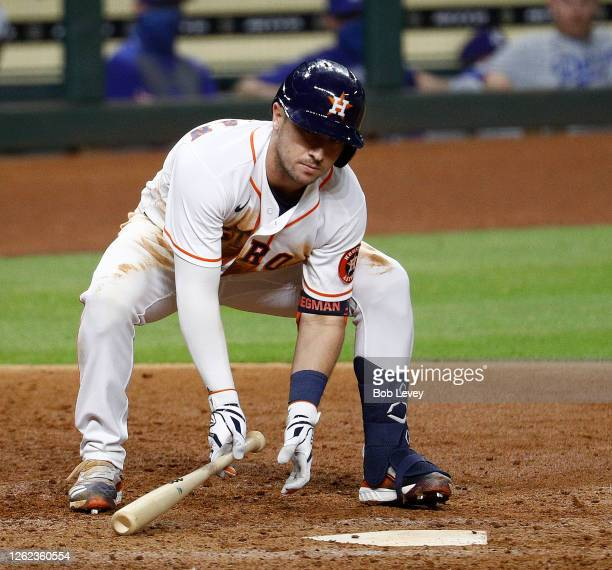 Alex Bregman of the Houston Astros reacts after Joe Kelly of the Los Angeles Dodgers threw a pitch at his head in the sixth inning at Minute Maid...
