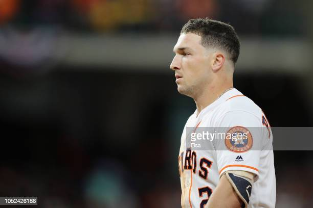 Alex Bregman of the Houston Astros reacts after lining out to Andrew Benintendi of the Boston Red Sox for the final out of the game during Game Four...