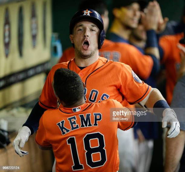 Alex Bregman of the Houston Astros receives a hug from Tony Kemp after hitting a tworun home run in the first inning against the Detroit Tigers at...