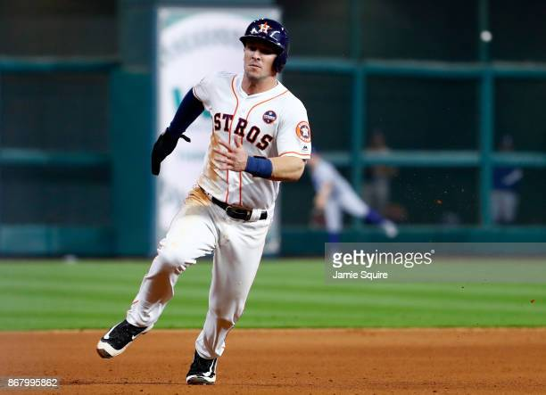 Alex Bregman of the Houston Astros rounds third base on his way to score during the seventh inning against the Los Angeles Dodgers in game five of...