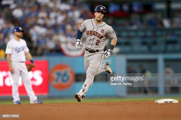 Alex Bregman of the Houston Astros runs the bases after hitting a solo home run during the fourth inning against the Los Angeles Dodgers in game one...