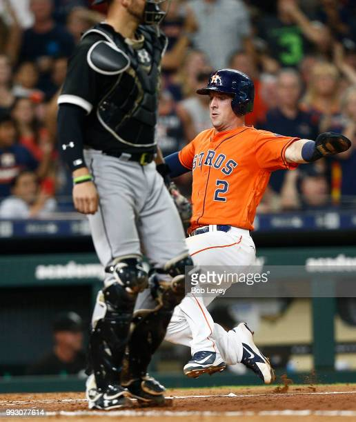 Alex Bregman of the Houston Astros scores in the fourth inning on a double by Tim Federowicz against the Chicago White Sox at Minute Maid Park on...