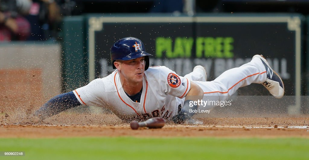 Alex Bregman #2 of the Houston Astros scores in the second inning against the Los Angeles Angels of Anaheim at Minute Maid Park on April 24, 2018 in Houston, Texas.