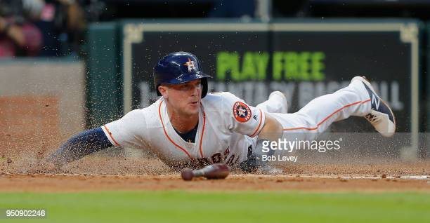 Alex Bregman of the Houston Astros scores in the second inning against the Los Angeles Angels of Anaheim at Minute Maid Park on April 24 2018 in...