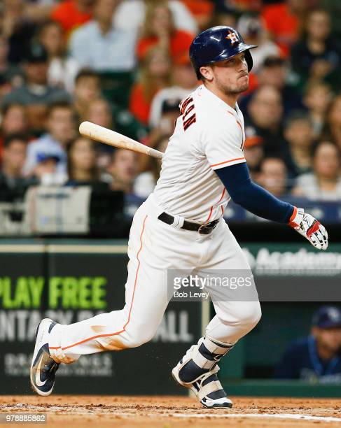 Alex Bregman of the Houston Astros singles in a run in the third inning against the Tampa Bay Rays at Minute Maid Park on June 19 2018 in Houston...
