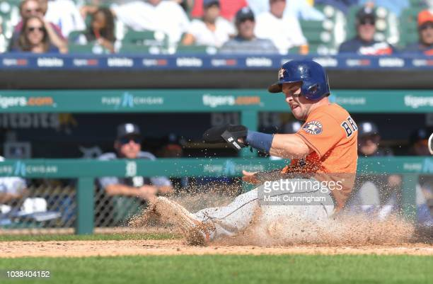 Alex Bregman of the Houston Astros slides safely into home during the game against the Detroit Tigers at Comerica Park on September 12 2018 in...