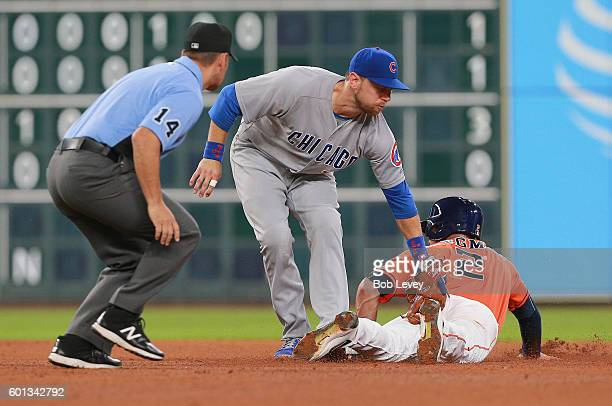 Alex Bregman of the Houston Astros steals second base in the fourth inning as Ben Zobrist of the Chicago Cubs is late on the tag at Minute Maid Park...