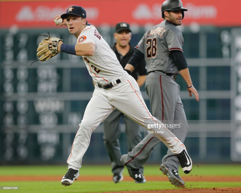 Alex Bregman #2 of the Houston Astros tags out J.D. Martinez #28 of the Arizona Diamondbacks and throws to first base to complete a double play in the sixth inning at Minute Maid Park on August 17, 2017 in Houston, Texas.