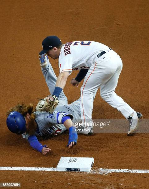 Alex Bregman of the Houston Astros tags out Justin Turner of the Los Angeles Dodgers at third base during the seventh inning in game five of the 2017...