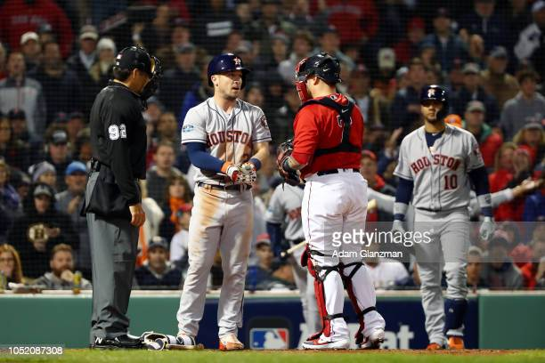 Alex Bregman of the Houston Astros talks with Christian Vazquez of the Boston Red Sox after getting hit by a pitch in the sixth inning during Game 1...