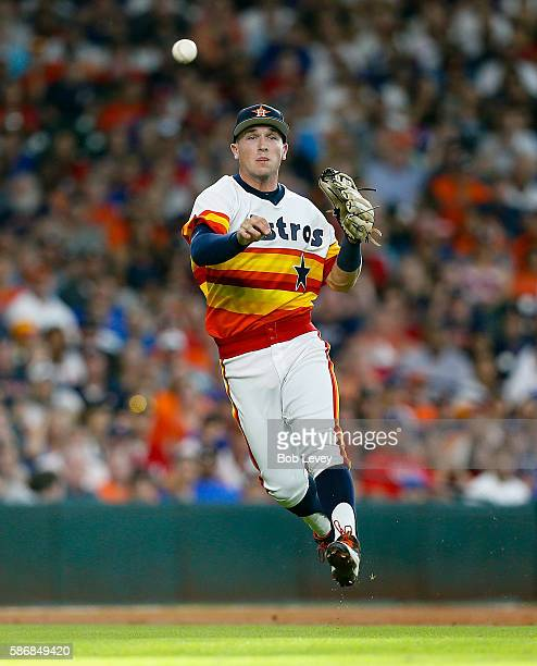 Alex Bregman of the Houston Astros throws out Ian Desmond of the Texas Rangers in the second inning at Minute Maid Park on August 6 2016 in Houston...