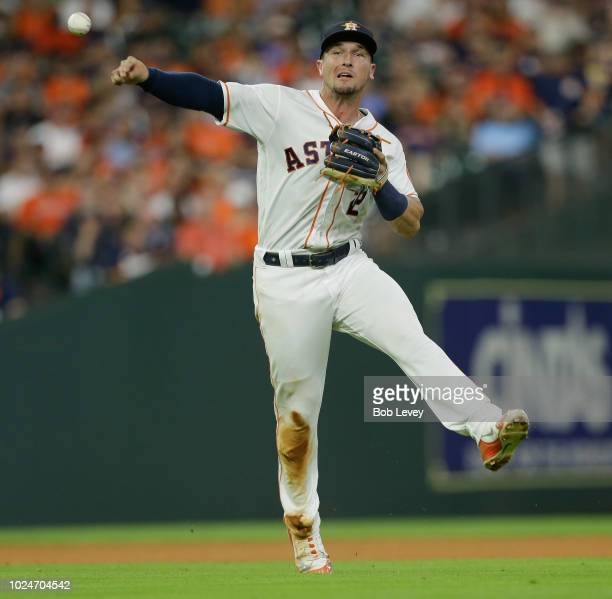 Alex Bregman of the Houston Astros throws out Jonathan Lucroy of the Oakland Athletics in the fifth inning at Minute Maid Park on August 27 2018 in...