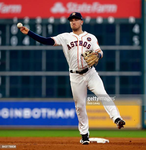 Alex Bregman of the Houston Astros throws to first base against the New York Mets at Minute Maid Park on September 2 2017 in Houston Texas